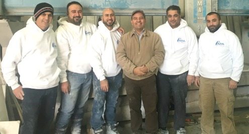 Centre: Owner (Mr. Maan Yoqoob) and Staff