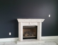 Granite Fireplace with Marble Flooring by Azul Granite & Marble Inc.